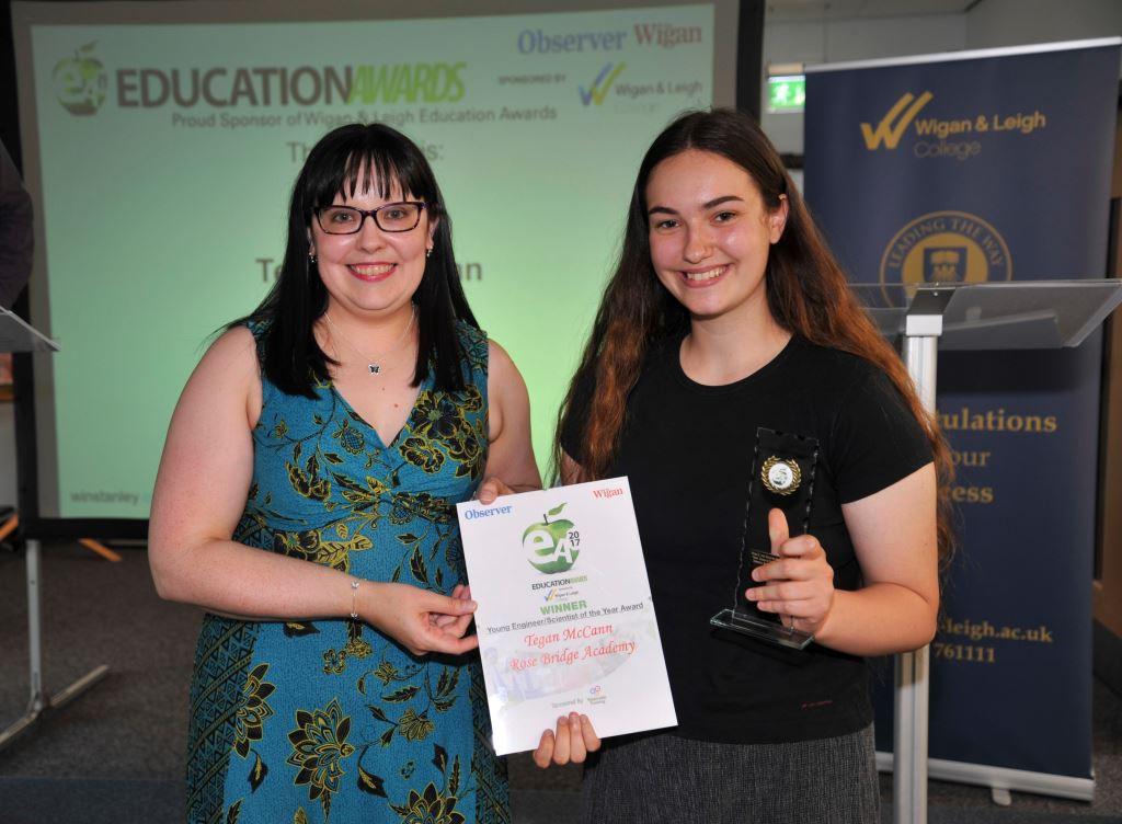 Kathryn Kirby (l) presents the Young Engineer/Scientist award to Tegan McCann (r)