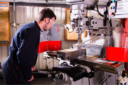 Picture of our student working on our engineering machines